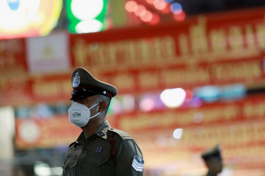 A Thai police officer during Chinese New Year celebrations in Bangkok's Chinatown on Jan 25, 2020. Thai prosecutors turned down about a fifth of human-trafficking cases sent to them by police last year, a soon-to-be-released government report shows.