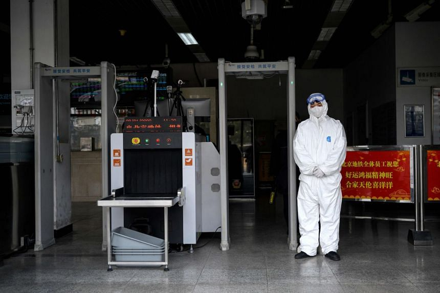A security personnel in protective clothing seen at the entrance of a subway station in Beijing on Jan 28, 2020.