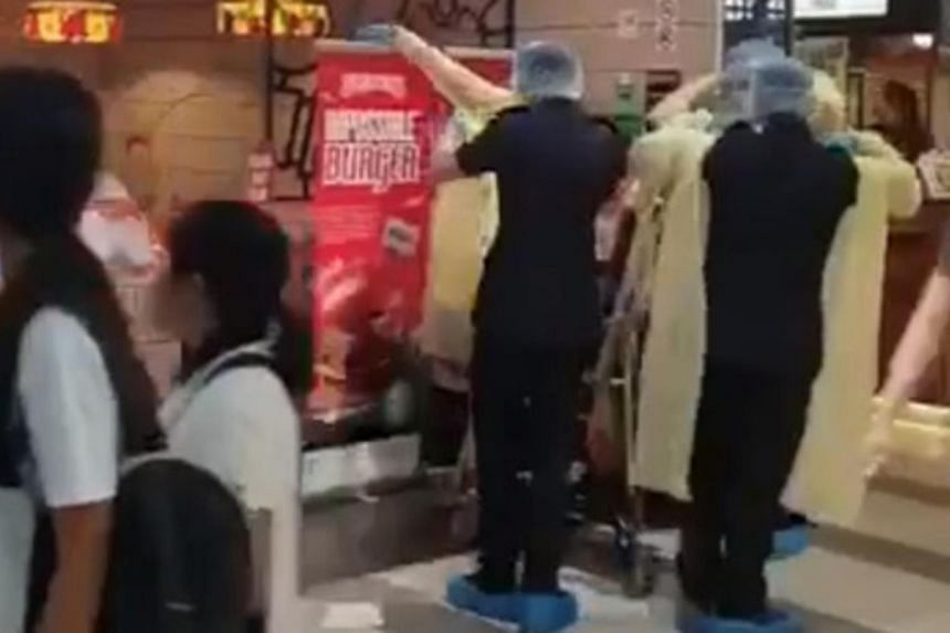Footage of medical workers donning protective garb at Compass One mall, which the Ministry of Health later clarified was not linked to the Wuhan virus.
