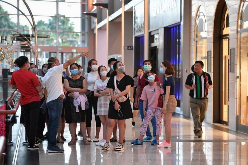 Visitors wearing masks as they walk around Marina Bay Sands on Jan 28, 2020.