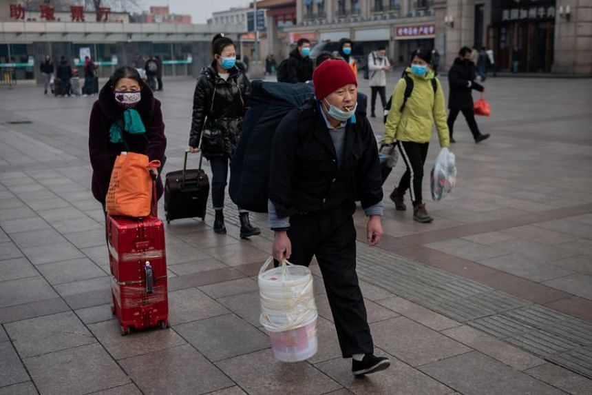 Commuters at the Beijing railway station on Jan 27, 2020. More than 50 million people have been barred from travelling in Wuhan and other cities in central Hubei province in an effort to contain the spread of the virus.