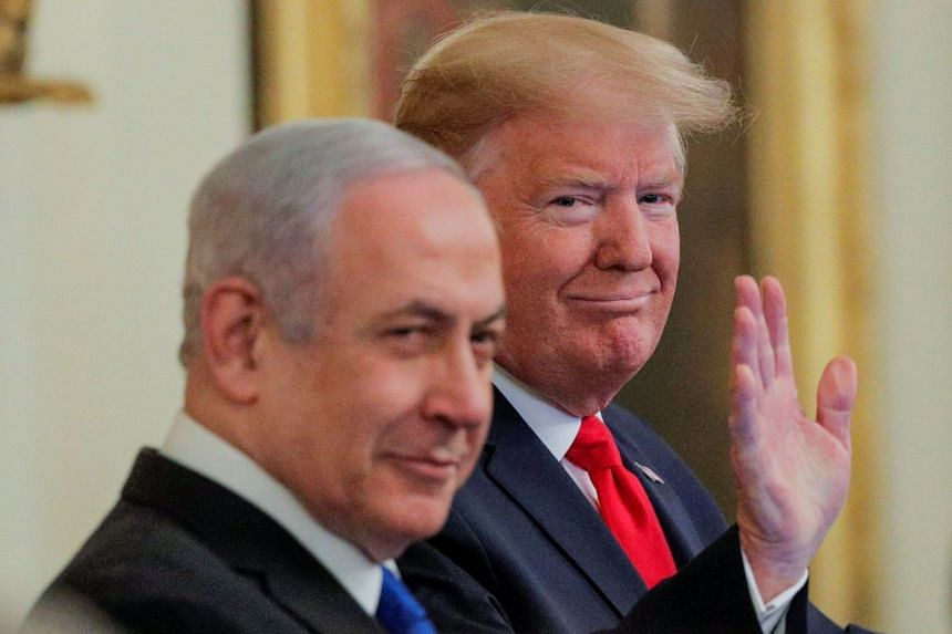 Trump waves next to Netanyahu prior to announcing his Middle East peace plan proposal.