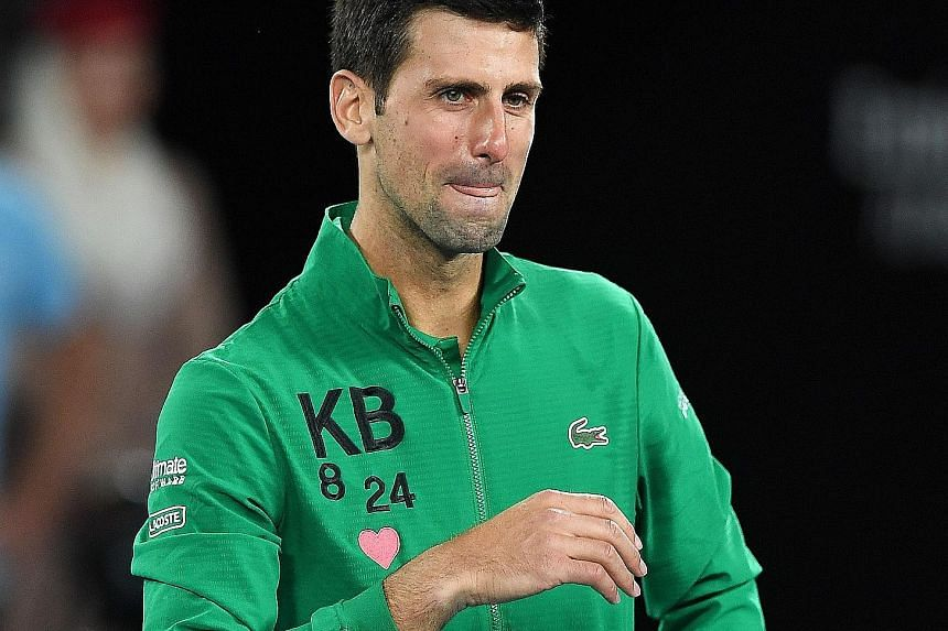 """Novak Djokovic paying tribute to recently deceased friend Kobe Bryant by sporting a sweater emblazoned with the basketball legend's initials """"KB"""" and his Lakers jersey numbers (8 & 24)."""