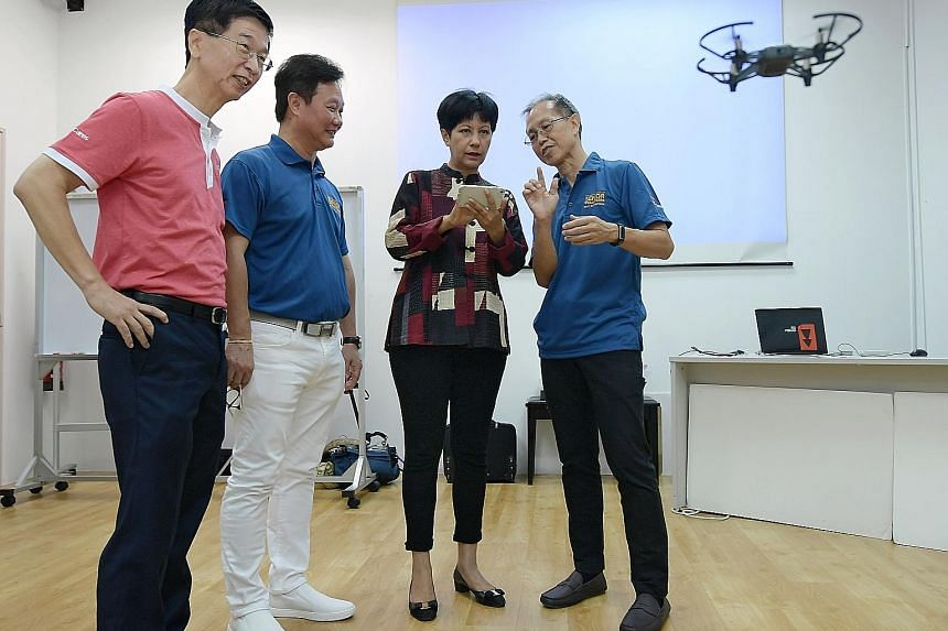 Minister in the Prime Minister's Office Indranee Rajah at a drone demonstration at RSVP Singapore yesterday. She was accompanied by (from left) Ministry of Culture, Community and Youth deputy secretary Ang Hak Seng, RSVP Singapore chairman Koh Juay M