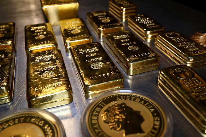 Gold bars and coins are stacked in the safe deposit boxes room of the Pro Aurum gold house in Germany on Aug 14, 2019.