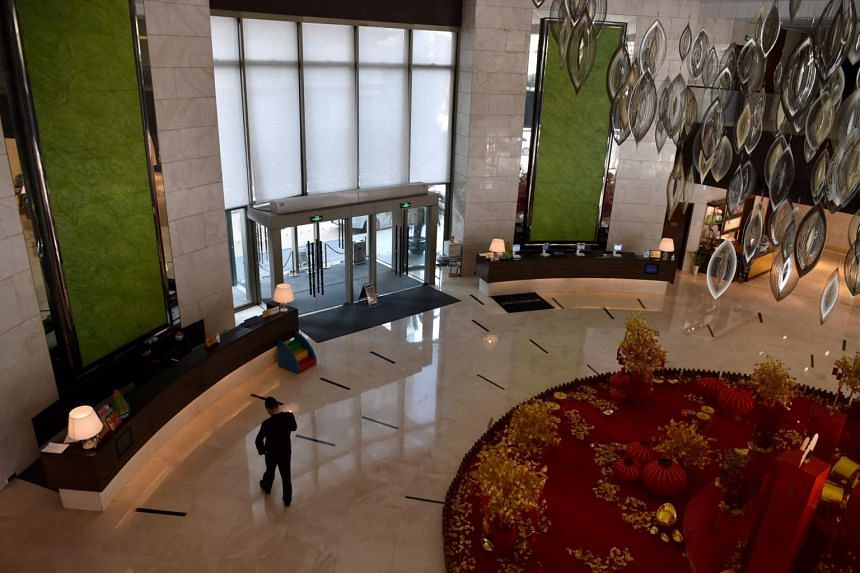 The lobby of Marco Polo in Wuhan, China, as seen on Jan 29, 2020. The hotel is one of the few to have remained open as the coronavirus crisis erupted.