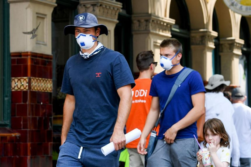 Pedestrians in face masks in the Australian city of Melbourne, on Jan 15, 2020.