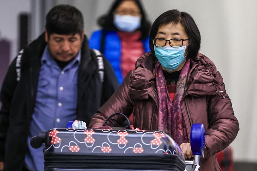 Passengers exit customs and screening areas as they arrive at Chicago O'Hare International Airport in the US on Jan 24, 2020.
