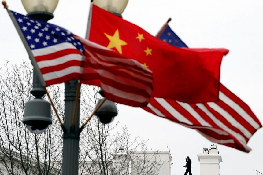 The flags of US and China seen near the White House in Washington, DC, in a photo taken in 2011.