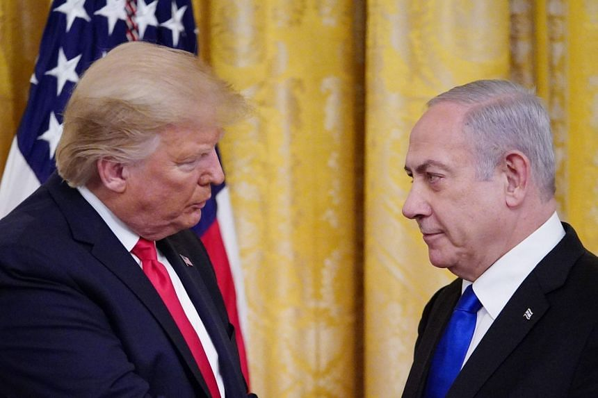 Trump (left) and Netanyahu take part in an announcement of Trump's Middle East peace plan at the White House.