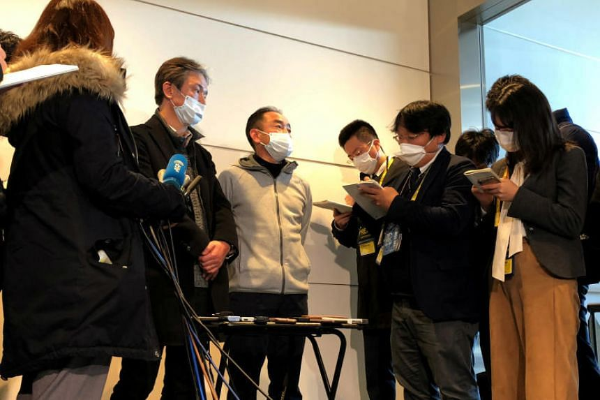 Mr Takeo Aoyama (left) and Mr Takayuki Kato, who were evacuated by a Japanese chartered plane from Wuhan, speaking to the media after their arrival at Haneda airport in Tokyo on Jan 29, 2020.
