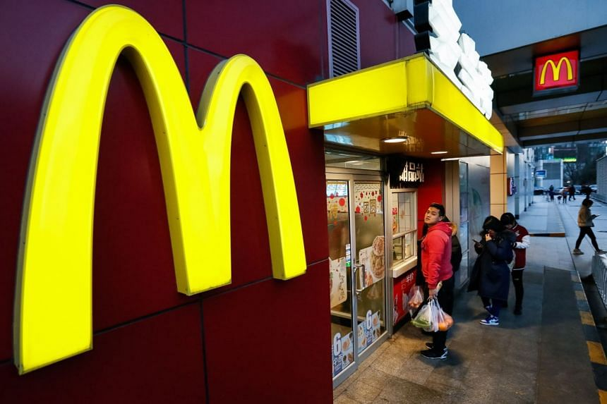 People queue to order food at a McDonald's restaurant in Beijing, China