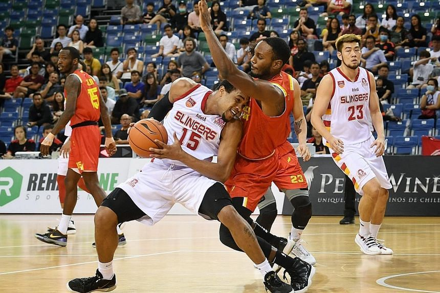 Singapore Slingers' Xavier Alexander (No. 15) meeting resistance in the form of his Saigon Heat marker, as teammate Delvin Goh looks on. The Slingers won the game at the OCBC Arena 101-67.