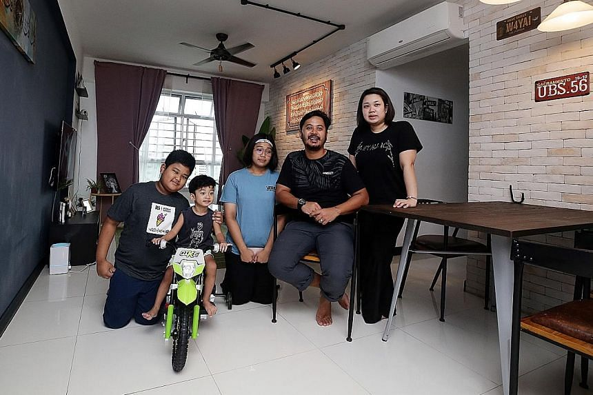 Mr Haikal Aziz, his wife Rashidah Ahmat, daughter Nur Atiqah Natasya (in blue T-shirt) and sons Md Khalish Rizqin and Md Hayyan Rizqin (on bicycle), in their four-room BTO flat in Choa Chu Kang. They are looking to upgrade to an executive flat nearby
