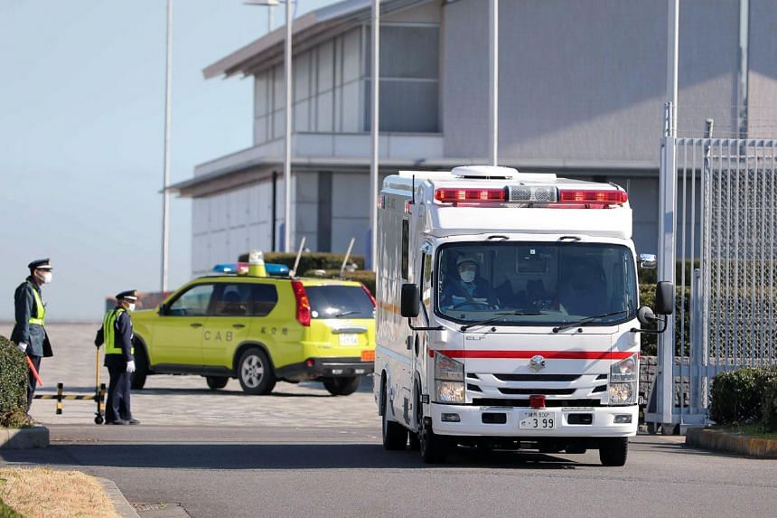 An ambulance departs Haneda Airport following the arrival in Tokyo of the second charter flight to evacuate Japanese citizens from Wuhan on Jan 30, 2020.