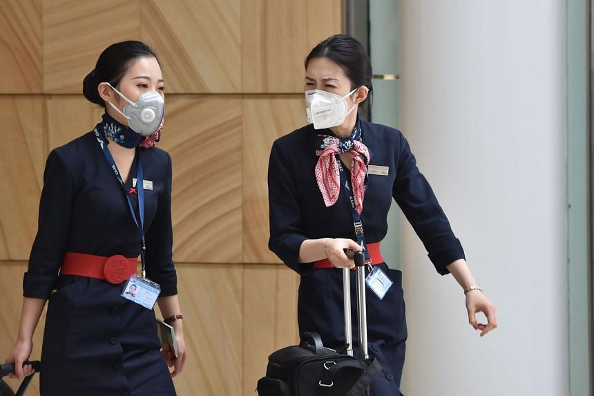 China Eastern Airlines aircrew arrive at Sydney airport after landing on a plane from Shanghai, on Jan 25, 2020.