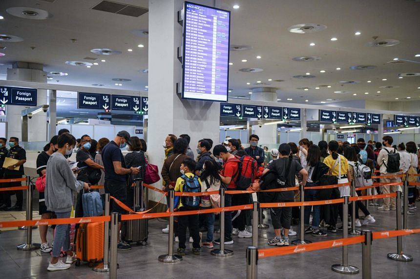 Passengers wearing face masks queue at the immigration counter upon arrival at the Kuala Lumpur International Airport 2, on Jan 29, 2020.