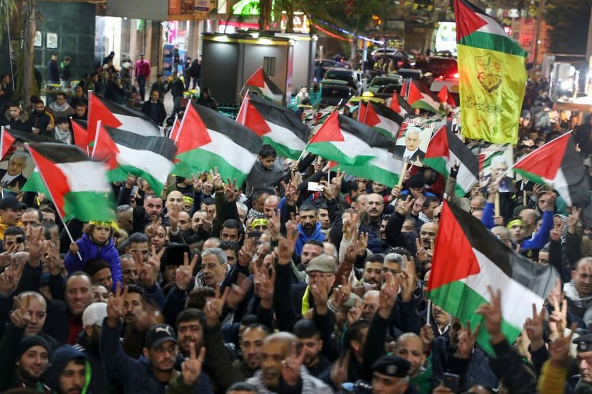 Palestinians taking part in a demonstration in the West Bank city of Nablus, on Jan 28, 2020.