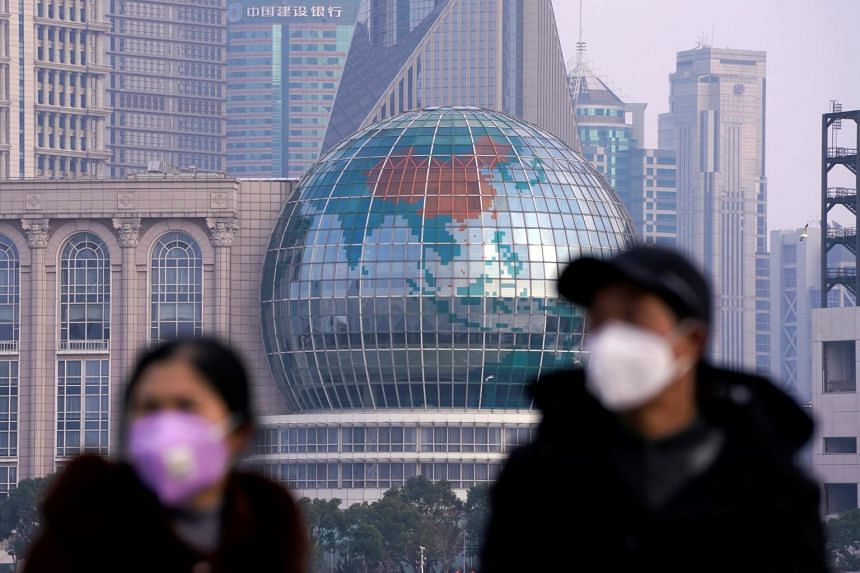 People are seen wearing protective masks in Shanghai on Jan 29, 2020.