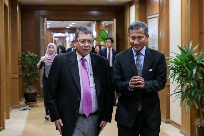 Malaysian Foreign Minister Saifuddin Abdullah with Minister for Foreign Affairs Vivian Balakrishnan in Putrajaya on Jan 30, 2020.