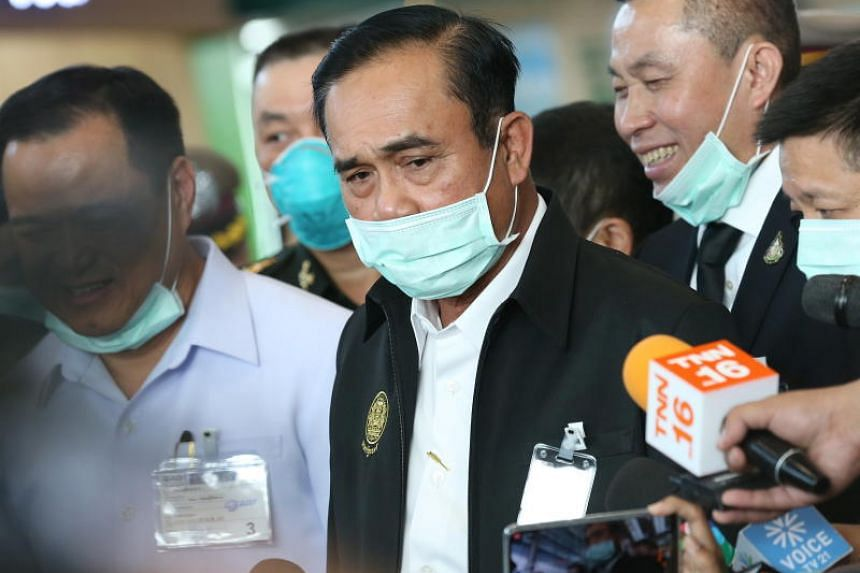 Thai Prime Minister Prayut Chan-o-cha wearing a protective mask while speaking to the media at the temperature-screening point in Suvarnabhumi Airport, on Jan 29, 2020.