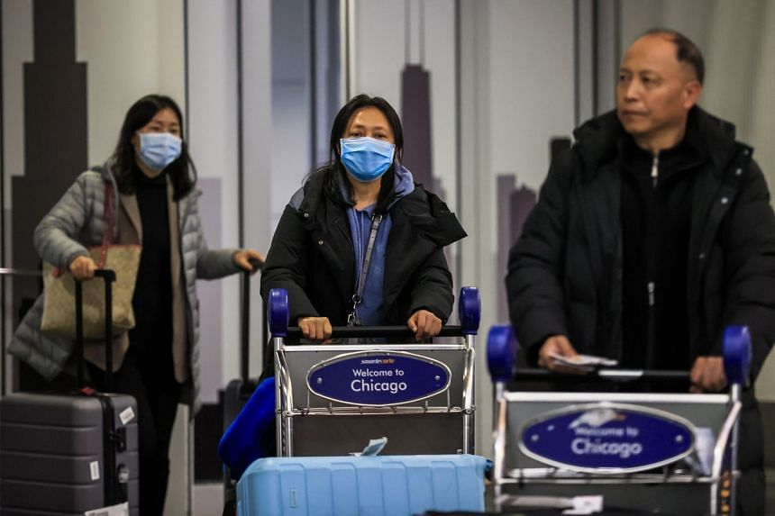 Passengers exit customs and screening areas as they arrive at O'Hare International Airport in Chicago, Jan 24, 2020.