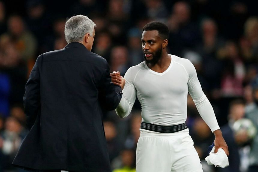 Danny Rose shakes hands with Tottenham manager Jose Mourinho after a match.