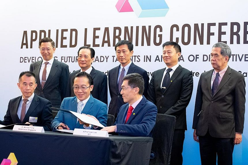 The memorandum of understanding for the training programme was signed yesterday by (sitting, from left) SMRT Trains chief executive Lee Ling Wee; SkillsFuture Singapore deputy chief executive for industry Michael Fung Jin Lung; and Associate Professo