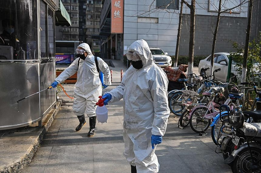 Workers disinfecting an area in Wuhan, Hubei province, on Wednesday. The public transport authorities have set up a system to deal with the spread of the virus amid the upcoming travel crunch after the week-long break.