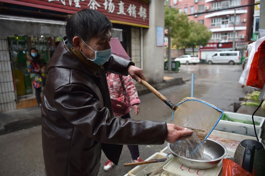 A vendor selling seafood at a market in Wuhan on Jan 24, 2020.