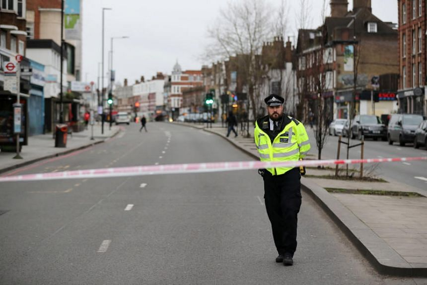 A police officer is seen near a site where a man was shot by armed officers in Streatham, south London in Britain, on Feb 2, 2020.