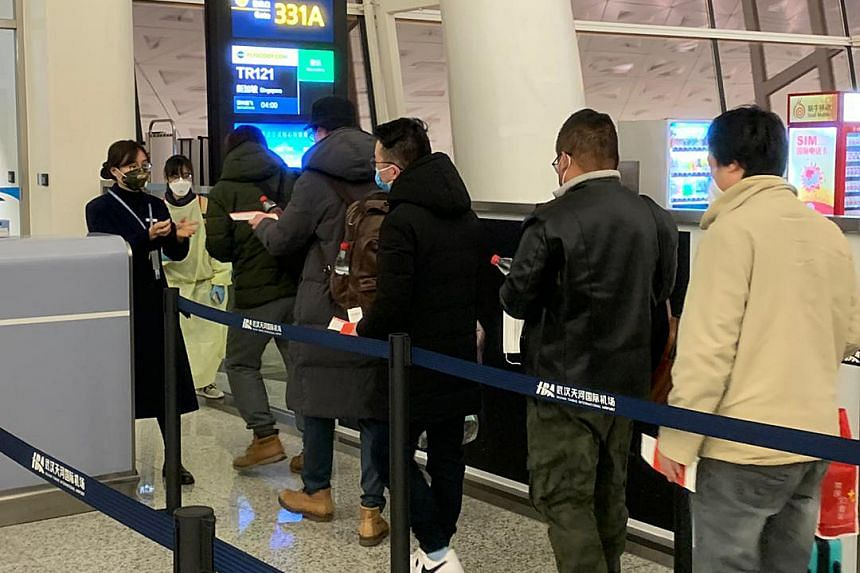 Passengers boarding a Scoot flight from Wuhan to Singapore on Jan 30, 2020.