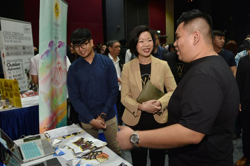 Senior Minister of State for Culture, Community and Youth and Communications and Information Sim Ann (centre) tours the Mentoring Summit 2020 alongside Youth Guidance Outreach Services staff members Sean Ravie (left) and Sean Foo.