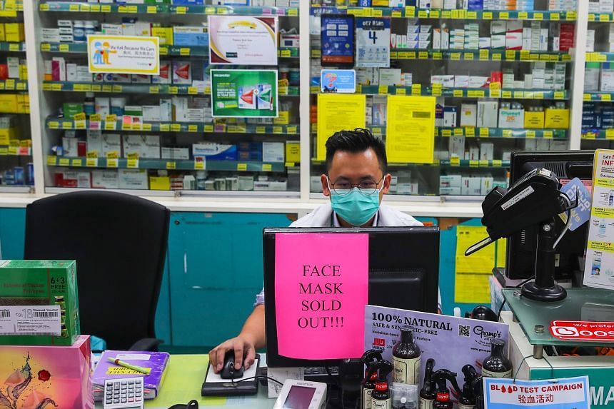 A sold-out sign for masks at a pharmacy in Kuala Lumpur yesterday. All eight confirmed cases in Malaysia are Chinese citizens.