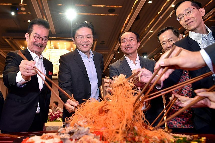 Real Estate Developers' Association of Singapore (Redas) president Chia Ngiang Hong (from left), Minister for National Development Lawrence Wong, Redas past president Augustine Tan, Ministry of Law deputy secretary Calvin Phua and Inland Revenue Auth