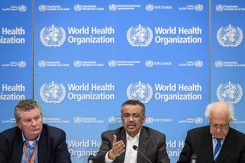 (From left) The World Health Organisation's health emergencies programme head Michael Ryan, director-general Tedros Adhanom Ghebreyesus and emergency committee chair Didier Houssin at a news conference in Geneva on Thursday, when the WHO declared the