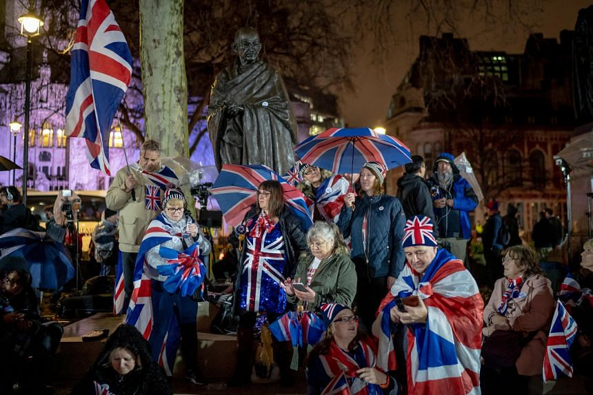 Brexit supporters celebrate in Parliament Square in London on Jan 31, 2020.