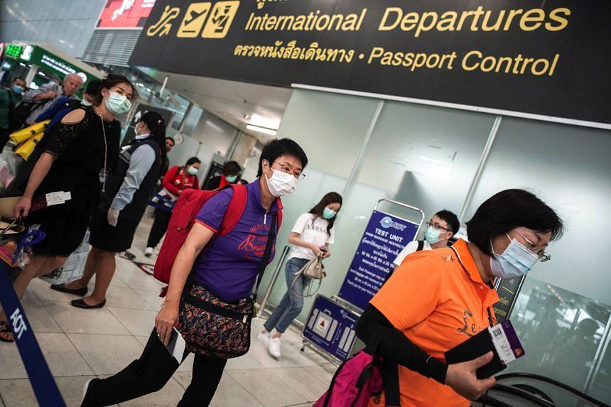 Tourists wear protective face masks at the Suvarnabhumi International Airport in Bangkok on Jan 31, 2020.