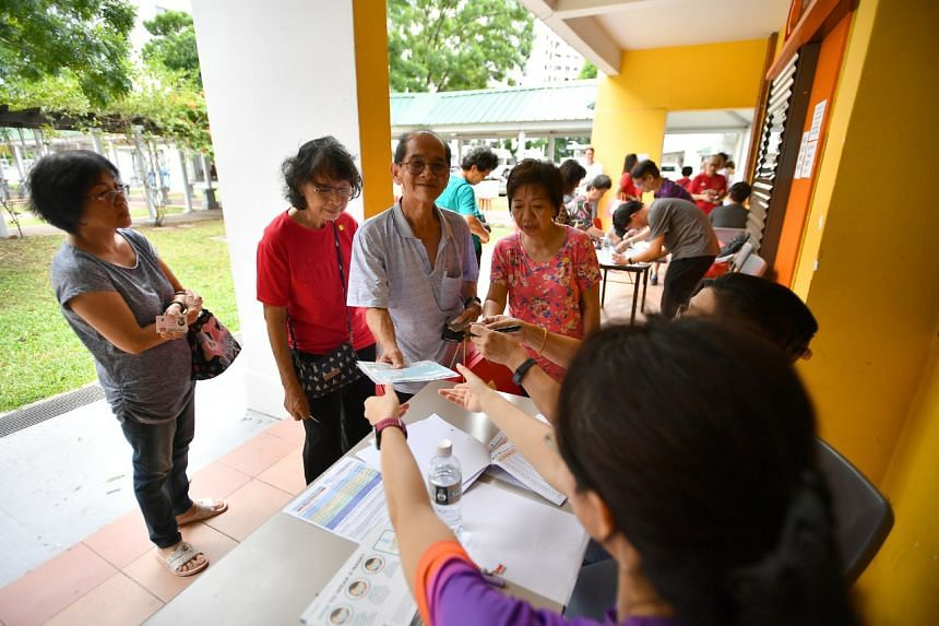 Residents collecting their masks at Paya Lebar Zone 4 residents' committee centre on Feb 1, 2020.