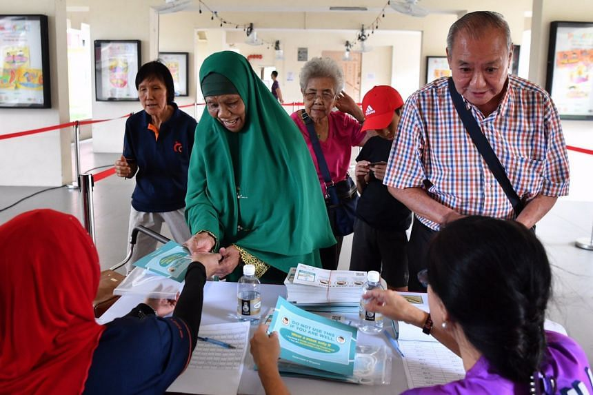 Residents collecting their masks at Toa Payoh Central Zone 4 residents' committee centre on Feb 1, 2020.
