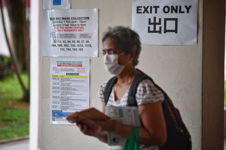A poster informing residents of mask collection points and timings at Toa Payoh Central Zone 4 residents' committee centre.