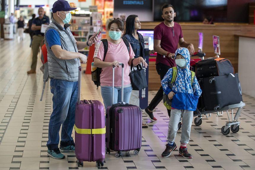Passengers at Brisbane International Airport on Jan 31, 2020.