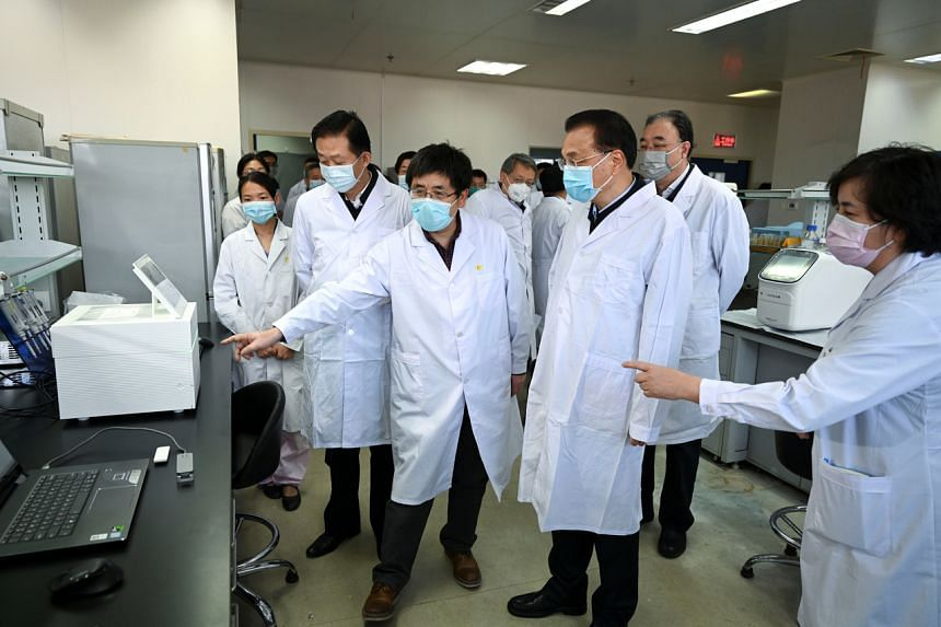 Chinese Premier Li Keqiang (second from right), who heads a leading group on the prevention and control of the novel coronavirus outbreak, visits the Chinese Centre for Disease Control and Prevention in Beijing on Jan 30, 2020.