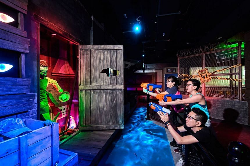 "Players blasting ""zombies"" at the Nerf Action Xperience arena."