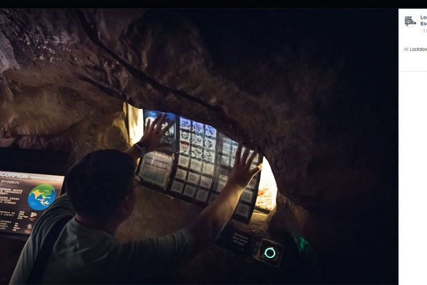A player cracking a puzzle in an escape game held at the Night Safari last year.