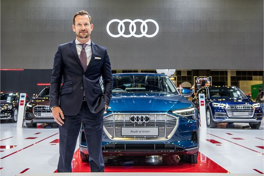 Mr Markus Schuster, Audi Singapore managing director, with the e-tron, Audi's first fully electric production SUV, at its launch at the Singapore Motorshow 2020.
