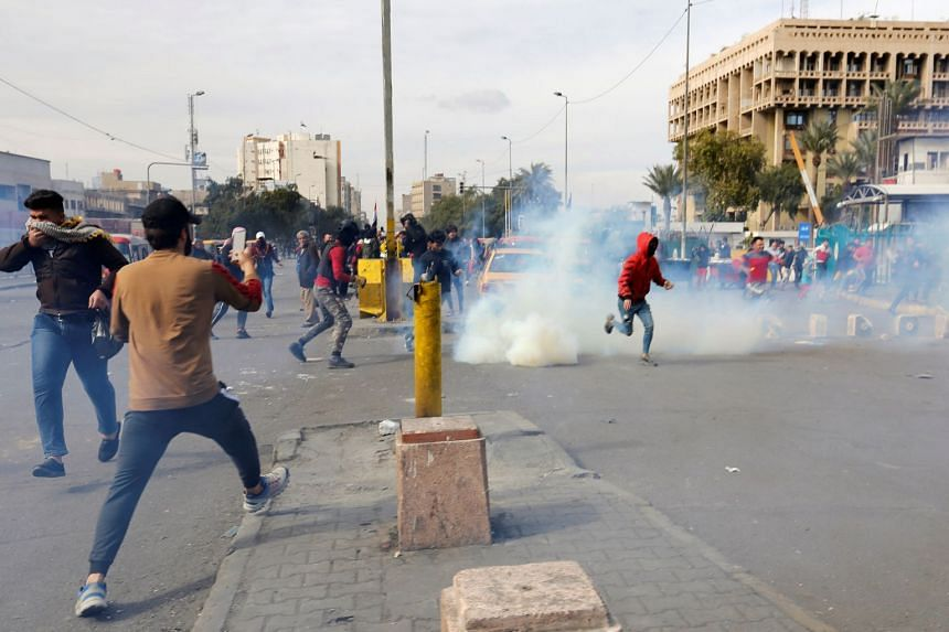 Iraqi demonstrators disperse after security forces fired tear gas during ongoing anti-government protests in Baghdad, Feb 1, 2020.