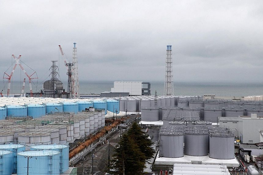 Storage tanks containing radioactive water at Tokyo Electric's tsunami-crippled Fukushima Daiichi nuclear power plant in Japan. The utility says the site will run out of room to store the contaminated water by 2022.