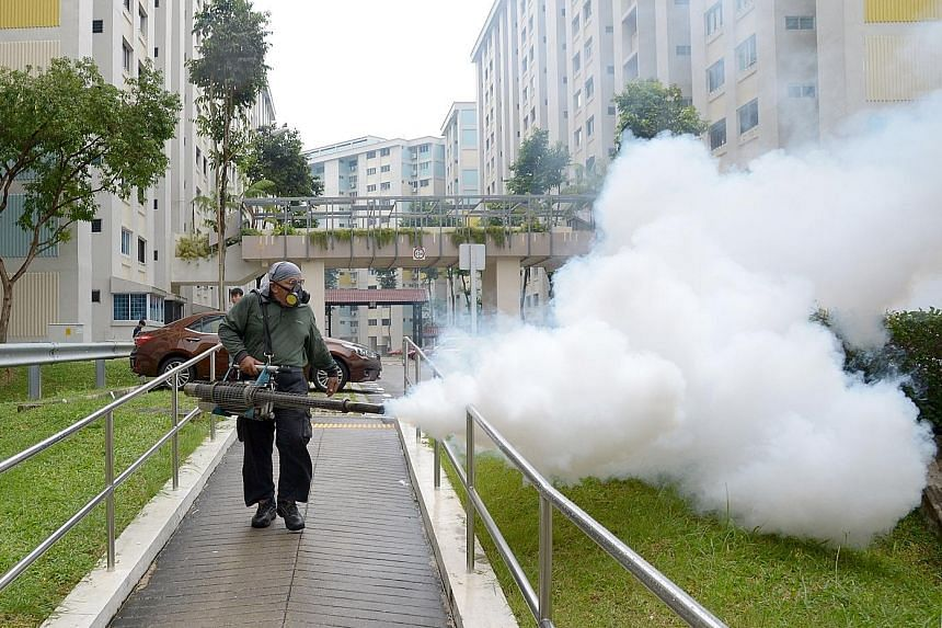 Fogging being done in a precinct at Bishan, after the Health Ministry confirmed the localised community spread of the Zika virus, which is transmitted primarily by the Aedes mosquito, on Aug 28, 2016. Passengers arriving from Qatar walking past a the