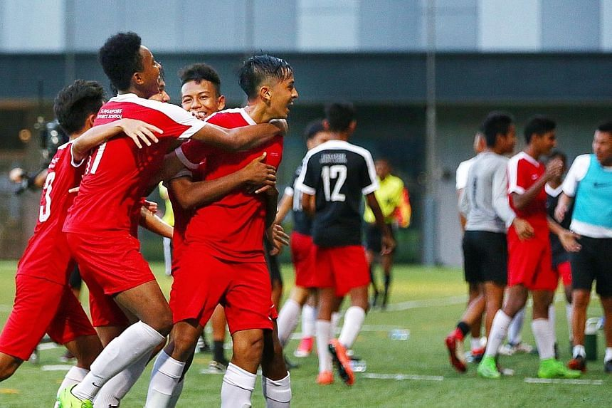 Singapore Sports School players (in red) celebrating on the way to beating Meridian Secondary School in the National School Games B Division final in April 2018. The sports school has won the B Division title eight times since 2007, and its recent 32